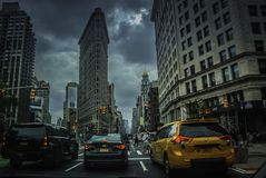 Skyscrapers with many cars in New York. New York City comprises 5 boroughs sitting where the Hudson River meets the Atlantic Ocean. At its core is Manhattan, a stock photos