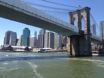 Brooklyn bridge new york via ferry stock photography