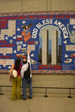 New York City. Couple looking at a quilt on display at the National 9/11 Memorial Museum at Ground Zero royalty free stock image