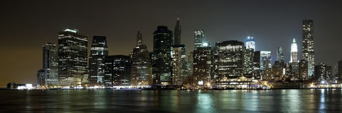The New York City Downtown w the Freedom tower. The New York City skyline at twilight w the Freedom tower Stock Photo