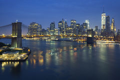 New York City at dusk with Brooklyn Bridge. Stock Images