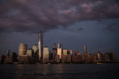 New York City at dusk under dark, purple sky Royalty Free Stock Images