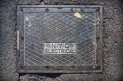 New York City electrical street box cover. New York City electrical box on the street Royalty Free Stock Image