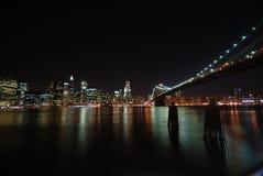 New York City em a noite Imagens de Stock Royalty Free