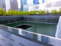 New York City, EUA - 1º de maio de 2016: Memorial no ponto zero, Manhattan, comemorando o ataque terrorista de setembro Imagem de Stock