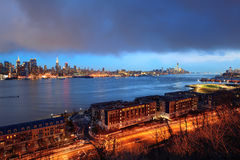 New York City evening. New York City midtown Manhattan in the evening with skyline panorama view over Hudson River royalty free stock images