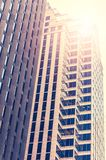 Skyscrapers from ground view with fogy sky visible. New York City - facade of skyscraper. High building in the middle of Manhattan. Retro filtered royalty free stock photography