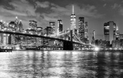 New York City, financial district in lower Manhattan with Brooklin Bridge at night, USA. New York City, financial district in lower Manhattan with Brooklyn stock images