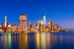 New York City. Financial district skyline at night on the Hudson River Royalty Free Stock Image