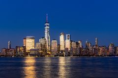 New York City Financial District skyscrapers at dusk. New York City Financial District skyscrapers and Hudson River at dusk. Panoramic view of Lower Manhattan Stock Image