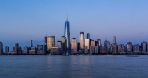 New York City Financial District skyscrapers. Timelapse from sunset to twilight. Lower Manhattan. New York City Financial District skyscrapers and Hudson River stock footage