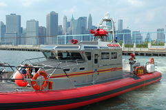 New York City Fire Boat. The newest fire boat in New York is called Bravest. Docked here on the Brooklyn shore of the East River with Manhattan in the background Royalty Free Stock Image