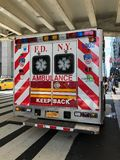 New York City Fire department New York ambulance. New York City NYFD ambulance rear view sitting parked outside Grand Central Station in New York City stock images