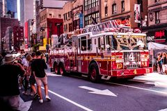 New York City Fire Truck Riding Through Crowd in the 8th avenue , Manhattan , New York City . NY 08/04/2018 stock photography