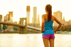 New York city fitness people lifestyle woman. New York city lifestyle active people living an urban active life. Fitness healthy woman runner relaxing after stock images