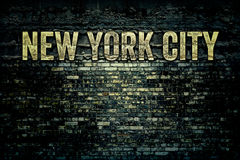 New York City Grungy Brick Wall. New York City Words on Grunge Brick Background Texture Royalty Free Stock Photography