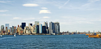 New York City Harbor. Lower Manhattan view from harbor with building and bridges in background Royalty Free Stock Images