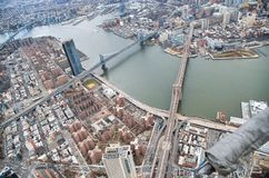 New York City from helicopter point of view. Brooklyn, Manhattan and Williamsburg Bridges with Manhattan skyscrapers on a cloudy. Day stock photos