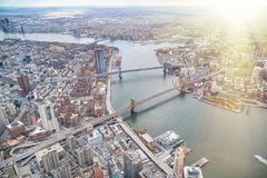 New York City from helicopter point of view. Brooklyn, Manhattan and  Williamsburg Bridges with Manhattan skyscrapers on a cloudy. Day royalty free stock image