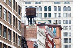 New York City historic Manhattan buildings with `open all borders` message stock photos
