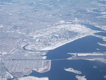 New York City JFK Airport in winter from air. Picture of JFK Airport covered in snow taken from airplane on January 14th, 2011 stock photo