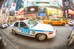 Times square in New York with yellow cabs and Police car Stock Photography
