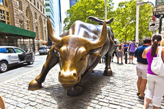 Landmark Charging Bull in Lower Manhattan in New York City. NEW YORK CITY - JULY 09: The landmark Charging Bull in Lower Manhattan represents the strength and Royalty Free Stock Images