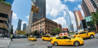 NEW YORK CITY - JUN 14, 2013: Yellow cab rides on city streets. Royalty Free Stock Photo
