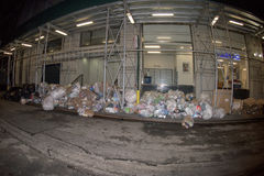 NEW YORK CITY - JUNE 16 2015: Garbage on the street at night Royalty Free Stock Image