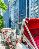 NEW YORK CITY - JUNE 2013: Horse carriage awaits customers on 59. St. It is a very popular attraction between tourists Royalty Free Stock Images