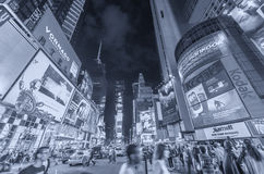 NEW YORK CITY - JUNE 9, 2013: Lights of Times Square at night. T. Imes Square is a popular tourist destination in New York City Royalty Free Stock Image