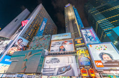 NEW YORK CITY - JUNE 9, 2013: Lights of Times Square at night. T. Imes Square is a popular tourist destination in New York City Royalty Free Stock Images