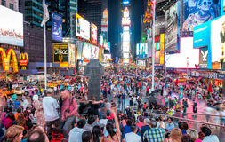 NEW YORK CITY - JUNE 12, 2013: Night view of Times Square lights. Times Square is a busy tourist intersection of neon art and commerce and is an iconic street Stock Photography