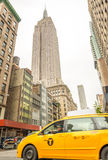 NEW YORK CITY - JUNE 12, 2013: Taxi cab in city street. The are Stock Image