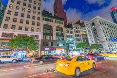 NEW YORK CITY - JUNE 8, 2013: Taxi speeds up along city street. Stock Photo