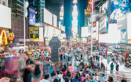 NEW YORK CITY - JUNE 2013: Times Square at night with tourists. Royalty Free Stock Images