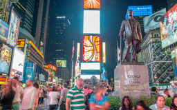 NEW YORK CITY - JUNE 2013: Times Square at night with tourists. Stock Photos