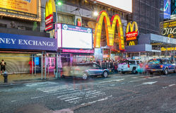 NEW YORK CITY - JUNE 2013: Times Square at night with tourists. Stock Images