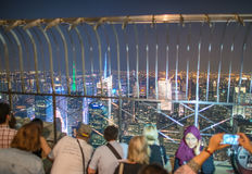NEW YORK CITY - JUNE 2013: Tourists enjoy city night view Royalty Free Stock Photo