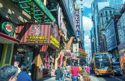 NEW YORK CITY - JUNE 14, 2013: Tourists walk along city streets Stock Images