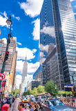 NEW YORK CITY - JUNE 14, 2013: Tourists walk along city streets Stock Photos