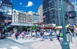 NEW YORK CITY - JUNE 14, 2013: Tourists walk along city streets Royalty Free Stock Photography