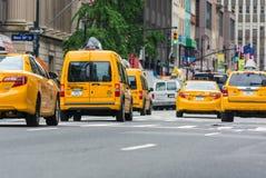 NEW YORK CITY - JUNE 13, 2013: Yellow cabs along Manhattan avenu Stock Photos