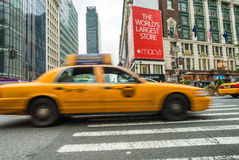 NEW YORK CITY - JUNE 13, 2013: Yellow cabs along Manhattan avenu Royalty Free Stock Image