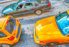 NEW YORK CITY - JUNE 2013: Yellow cabs speed up along city stree Royalty Free Stock Photography