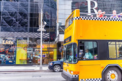 NEW YORK CITY - JUNE 11, 2013: Yellow checkered bus in Manhattan Stock Image