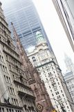 New York City, Lower Manhattan, skyscrapers on Broadway street. Royalty Free Stock Images