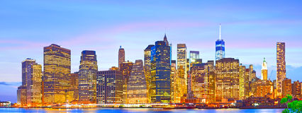 New York City lower Manhattan buildings skyline. Lower Manhattan New York City, financial business buildings illuminated at sunset Stock Photo