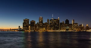 New York City Lower Manhattan skyscrapers between sunset, dusk and nightfall stock video
