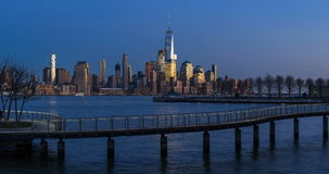 New York City Lower ManhattanFinancial District cityscape. Sunset to twilight time-lapse. New York City Lower Manhattan cityscape view from Hoboken NJ. Sunset to stock video